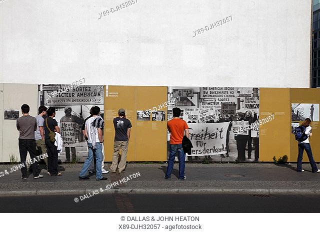 Germany, Berlin, Friedrich Strasse, Checkpoint Charlie, Tourists Reading about Berlin Wall, Berliner Mauer