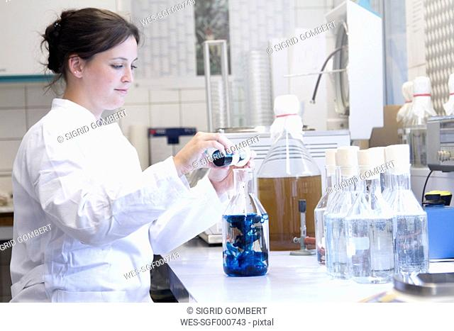 Female food analyst working in laboratory