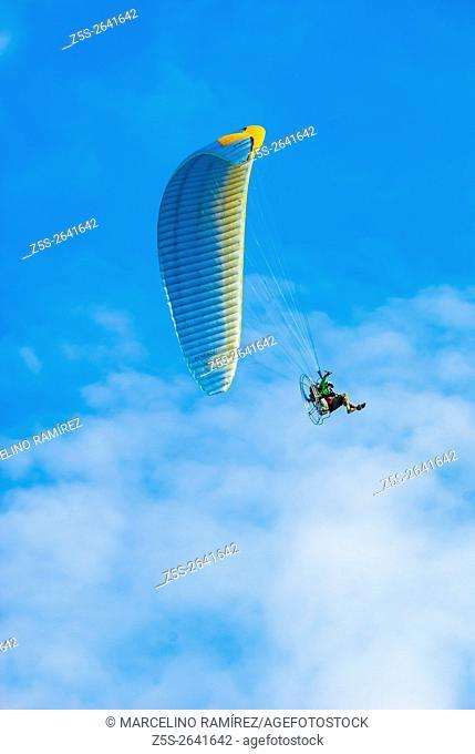 Paramotor flying in the sky. Niembro, LLanes, Asturias, Spain