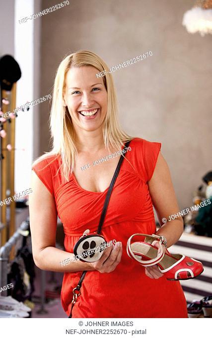 Happy woman in shop
