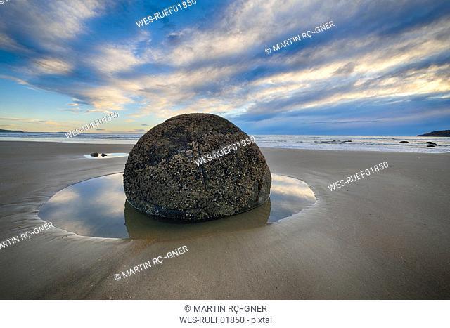 New Zealand, Otago coast, Moeraki Boulders on Koekohe Beach with dramatic sky