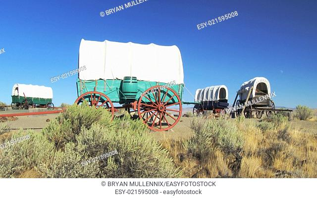 A covered wagon train forms a protective circle to camp along the Oregon Trail in eastern Oregon