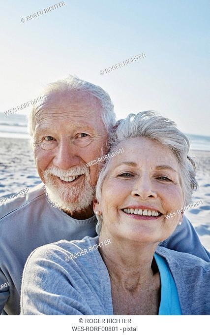 Portrait of smiling senior couple on the beach