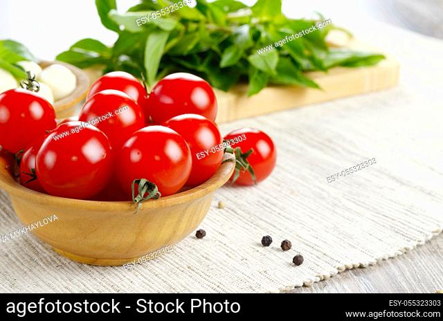 Mozzarella cheese, cherry tomatoes, basil leaves and olive oil - for caprese salad