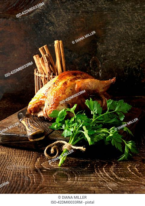 Roast chicken and parsley on board