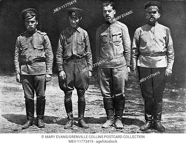 The photographer Donald C Thompson (second from left, 1885-1947) and three medical orderlies who worked for Colonel Eugene Hurd