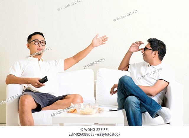 Men arguing. Two male friend having argument at home. Multiracial people friendship