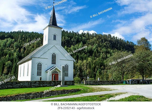 Vinje Norway beauiful white church called Vinje Church with red door and forest of trees