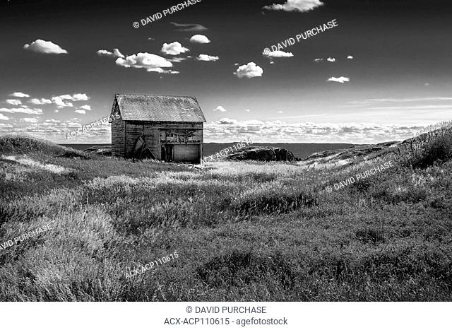 weathered by the wind & salt water, old family residence of a fishing family, Change Islands, Newfoundland & Labrador