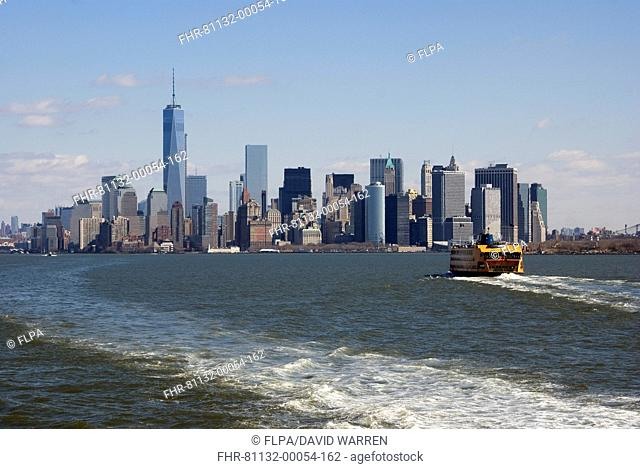 View of ferry on river and city skyline with One World Trade Center skyscraper, Hudson River, Lower Manhattan, Manhattan Island, New York City, New York State