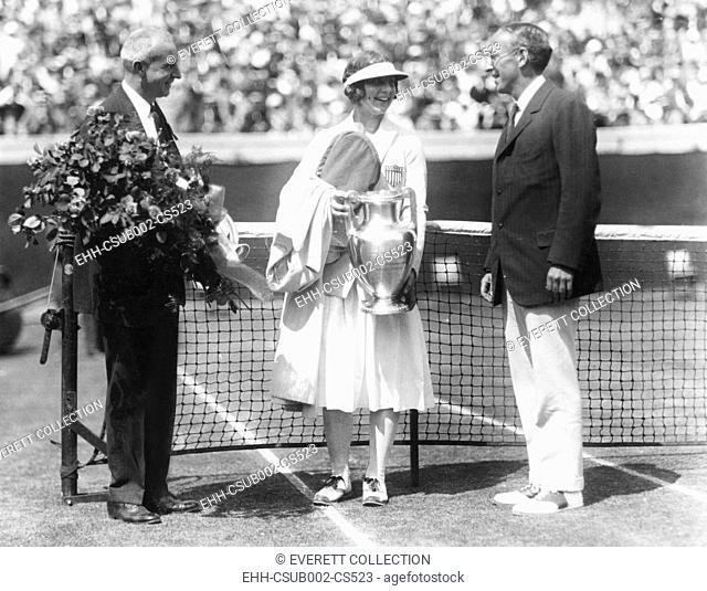 Helen Wills holds the trophy for winning the National Women's Singles Championship. August 18, 1923. 17 year old Wills won her final match with Molla Mallory in...