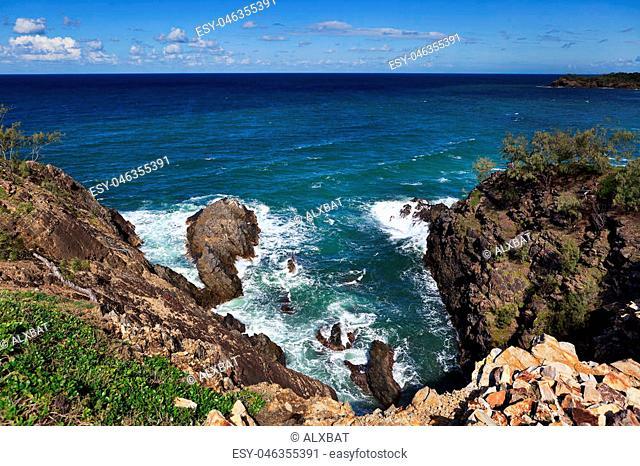 Looking down the sea cliffs at Devil's kitchen, Sunshine Coast, QLD