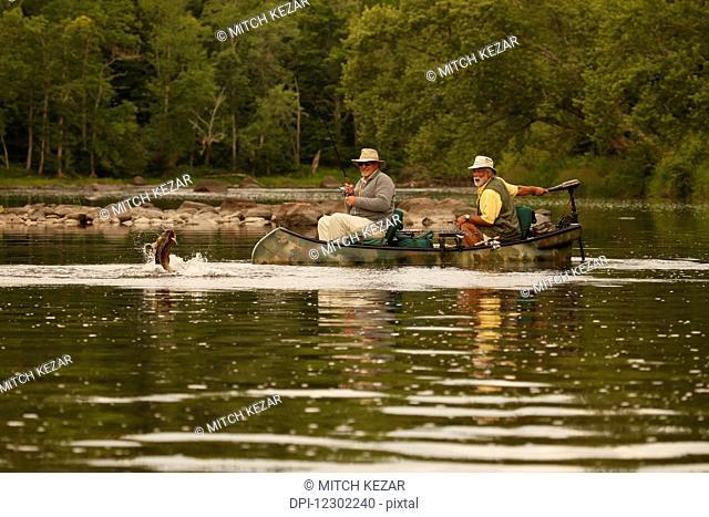 Bass Fishermen In Canoe In A River