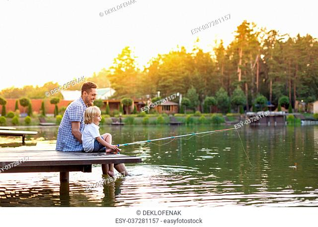 Dad and son with fishing rods