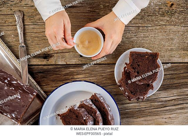 Homemade chocolate cake and cup of coffee on wood