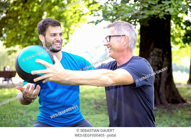 Man training with his personal trainer in a park
