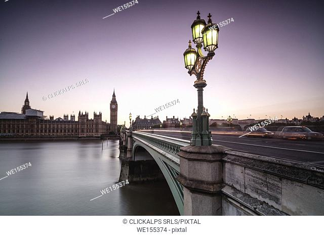 Old street lamp frames Westminster Bridge with Big Ben and Westminster Palace in the background London United Kingdom