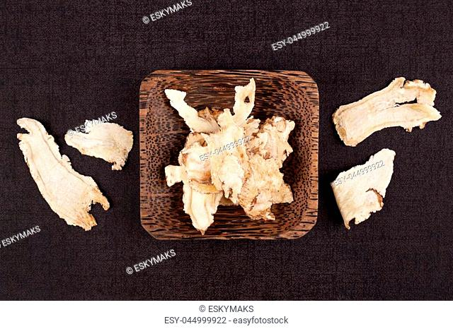 Angelica root used in chinese traditional herbal medicine over black background. Radix angelicae sinensis, Dang gui