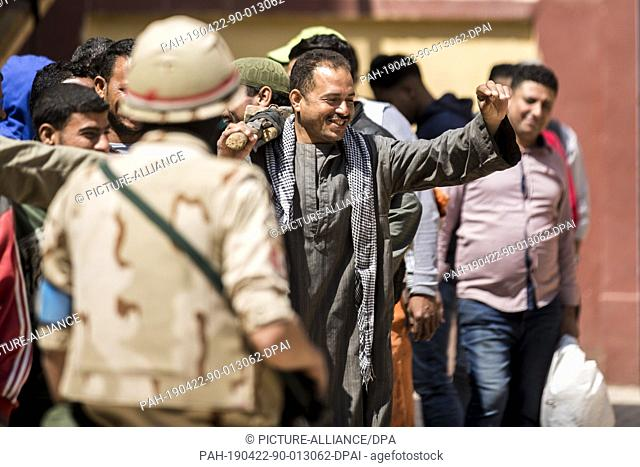 22 April 2019, Egypt, Cairo: A man sings and dances outside a polling station during the third and last day of the national referendum on the constitutional...