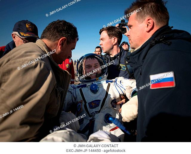 NASA astronaut Shane Kimbrough is helped out of the Soyuz MS-02 spacecraft just minutes after he, Russian cosmonaut Sergey Ryzhikov of Roscosmos
