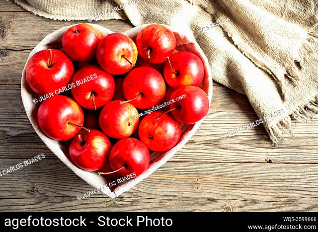 Red apples on a table