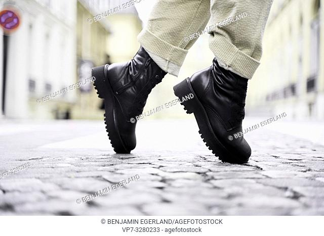 trendy black shoes tiptoe of fashionable woman at street during fashion week, in Paris, France