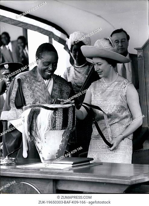 Mar. 03, 1965 - Princess Margaret receives a drum royal tour of Uganda. photo shows H.R.H. Princess Margaret seen as she received the presentation of a native...