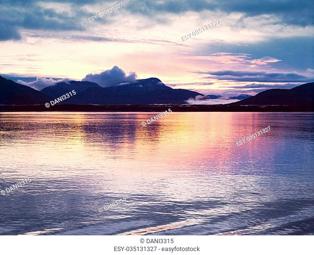 Sunset at Glacier Bay, Alaska. Sunset reflection in the calm waters of Glacier Bay