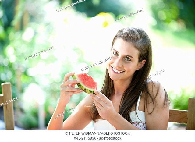 Young, beautiful woman in garden (model-released)