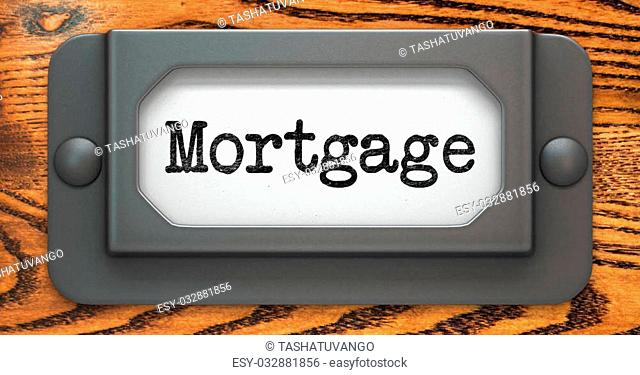 Mortgage - Inscription on File Drawer Label on a Wooden Background