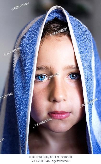 Young girl with a towel around her head after a shower
