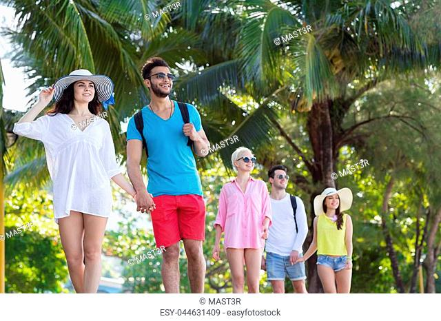 Young People Group Tropical Park Palm Trees Friends Walking Speaking Holiday Summer Vacation Ocean Travel