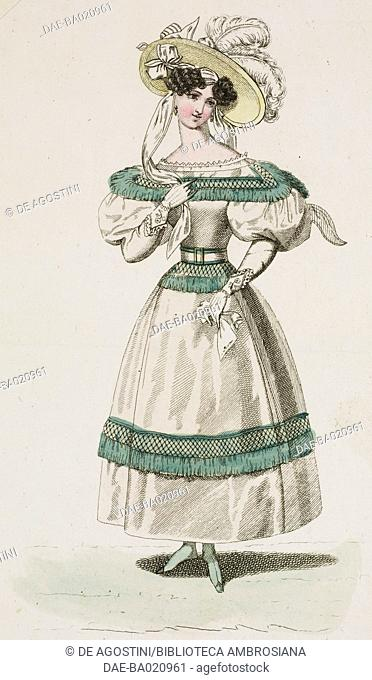 Woman wearing a white dress with green fringes on the shoulders, waist and skirt, and a light-coloured hat adorned with bows and hanging white feathers