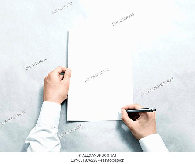Hand holding blank agreement mockup and signing it. Arm in shirt hold clear document template mock up. Contract surface design