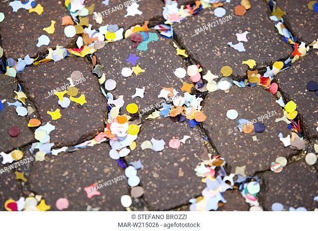 confetti, cobblestone street