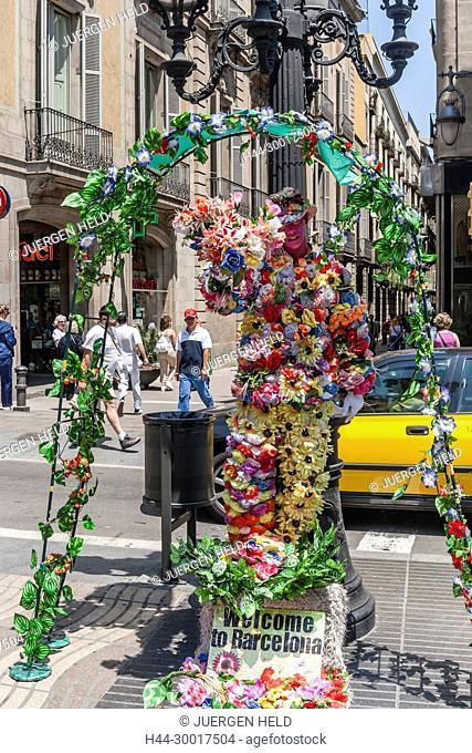 Spain, Catalonia, Catalunya, Barcelona, La Rambla, Human Statue with flowers