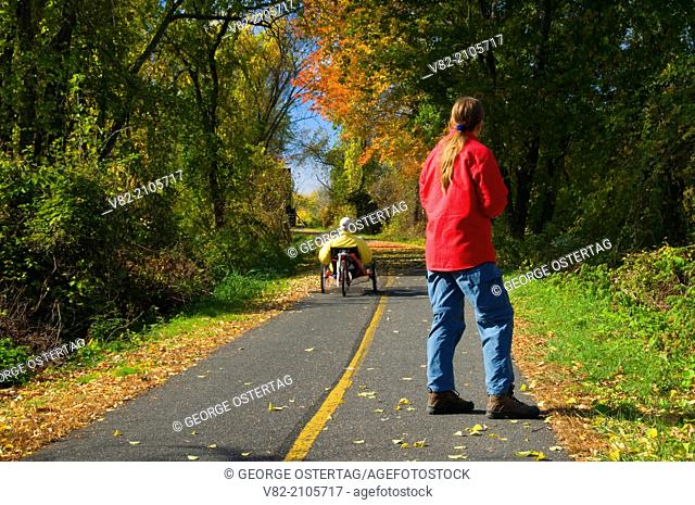 Walker on trail, Norwottuck Rail Trail State Park, Massachusetts