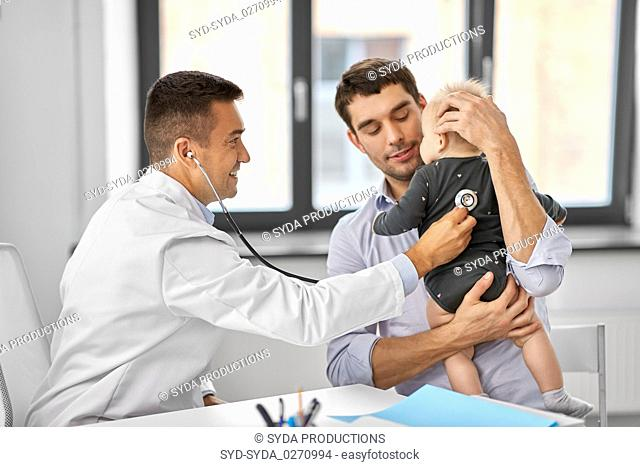 father with baby and doctor at clinic