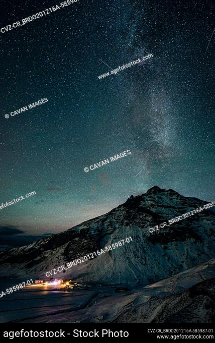 The milky way rises over a mountain in Iceland