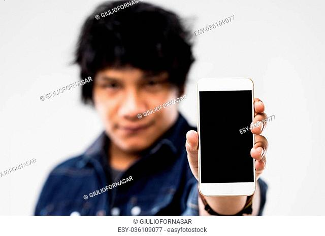blank screen of a smartphone (copyspace) shown to you by a robust mulatto guy