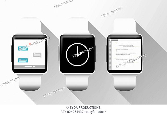 modern technology, object and media concept - close up of smart watches with applications on screen over gray background