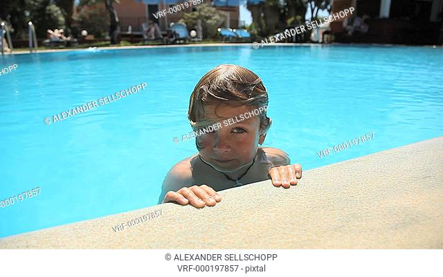 CU, A boy in a swimming pool