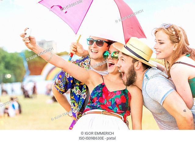Friends taking selfie at festival