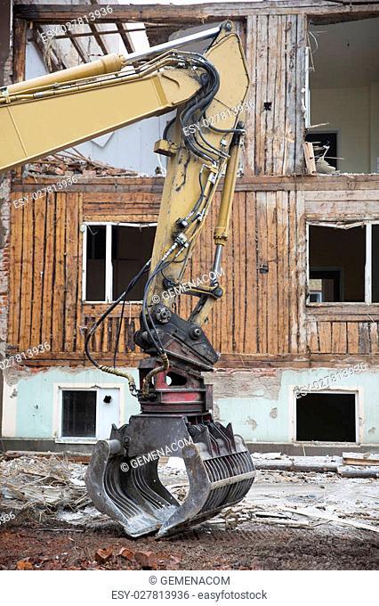 Close up of a Excavator demolish a House