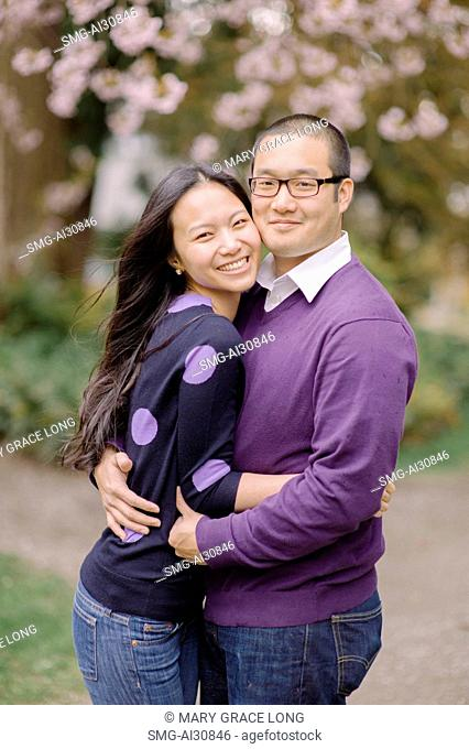USA, Portrait of couple hugging in park