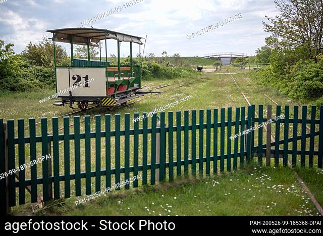 16 May 2020, Lower Saxony, Spiekeroog: The carriage stands in front of the building of the museum horse-drawn railway. It is considered an attraction for...