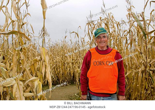 Farmington Maine fall activity Corn Maze in field with corn stalks and man in charge called Corn Cop in Northern New England in October