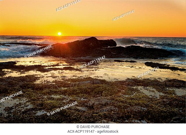 Sun dropping below the horizion at Green Point, Gros Morne National Park, Newfoundland and Labrador