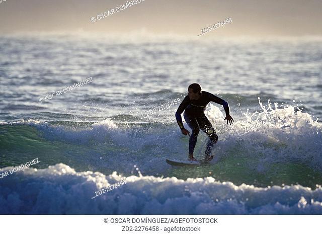 Surfer Pablo Macineira riding wave. Orzan Beach. A Coruña. Galicia. Spain