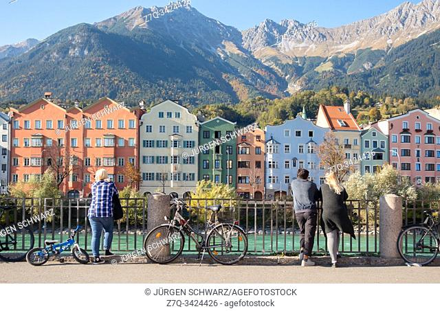 View on coloured houses of Mariahilf at the Inn in front of the Nordkette, Innsbruck, Tyrol, Austria
